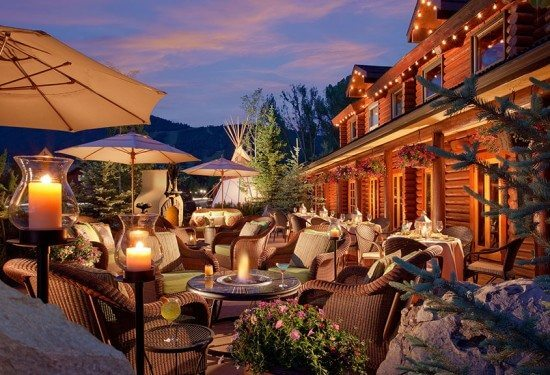 Lounge and dine on the deck of the Rustic Inn, Jackson Hole, WY