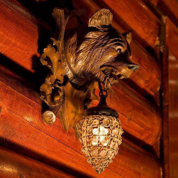 Bear carvings and ornaments are found throughout the Rustic Inn at Jackson Hole