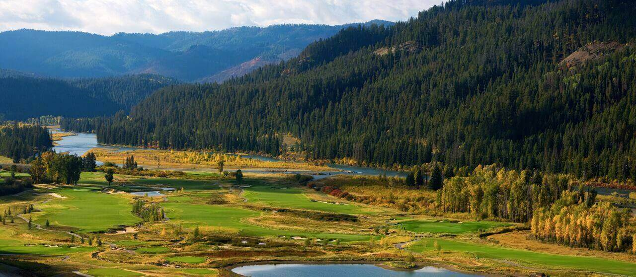 panoramic view of golf course with mountains in background