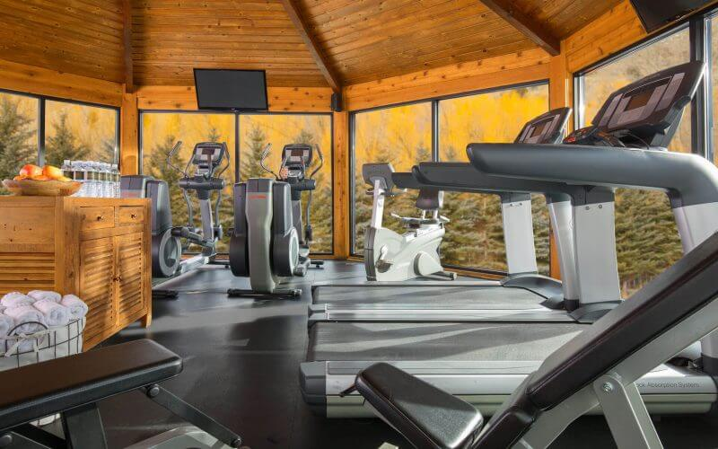 rustic inn gym with treadmills and ellipticals facing large windows
