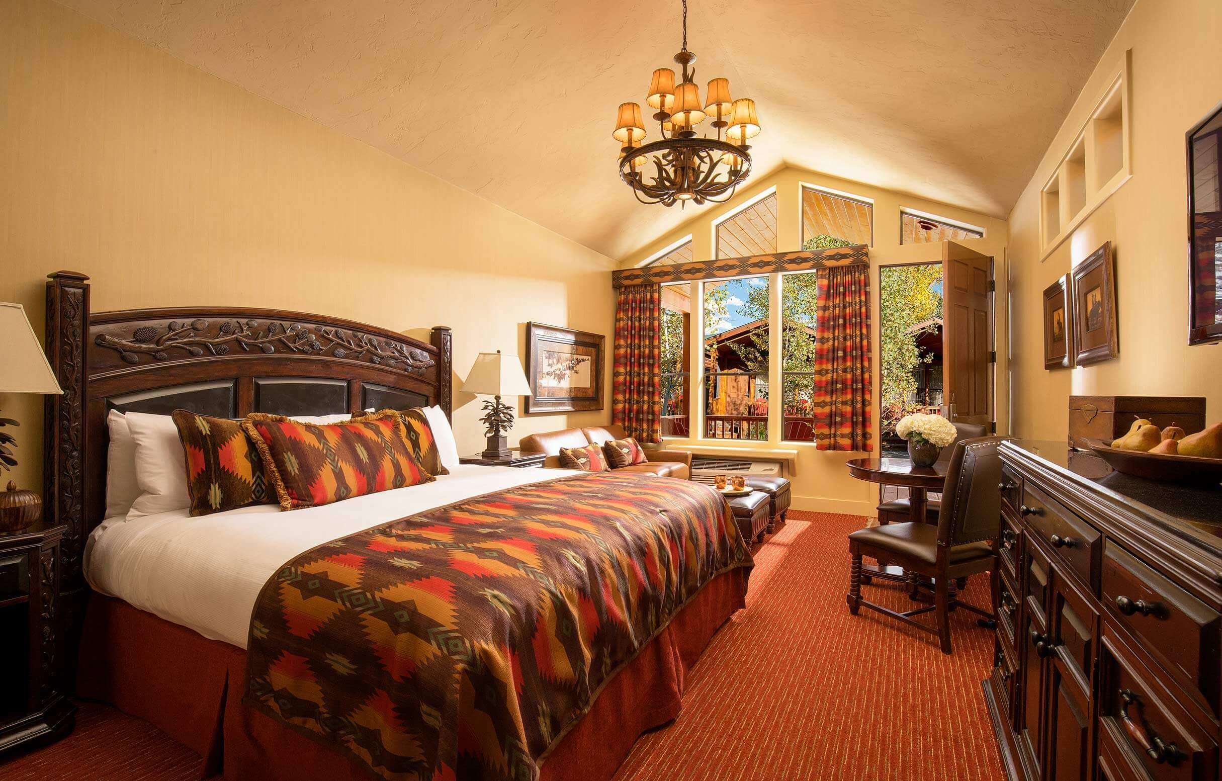 luxury hotel room with leather couches and king size bed