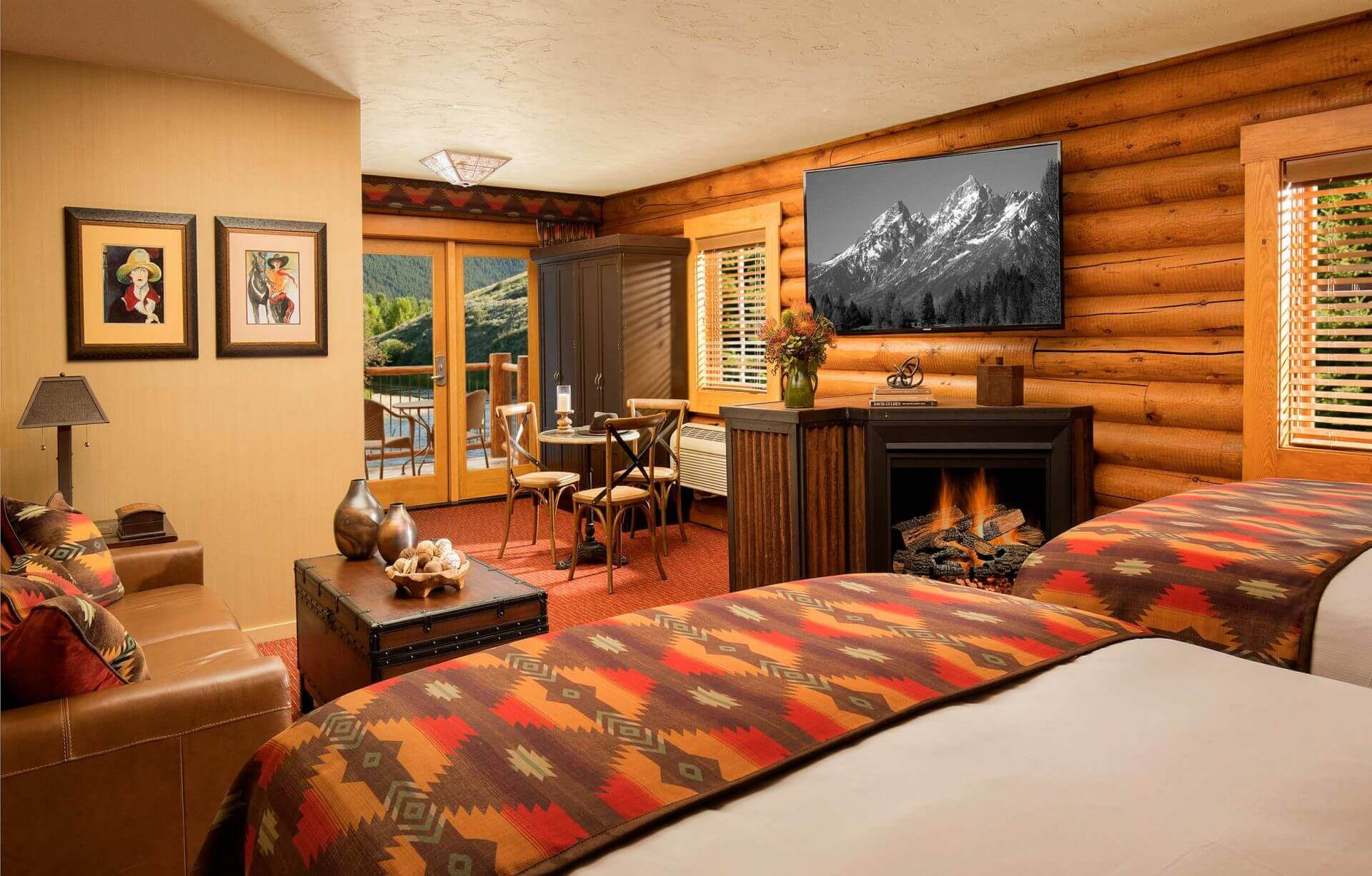 luxury hotel cabin with two queen beds and fireplace
