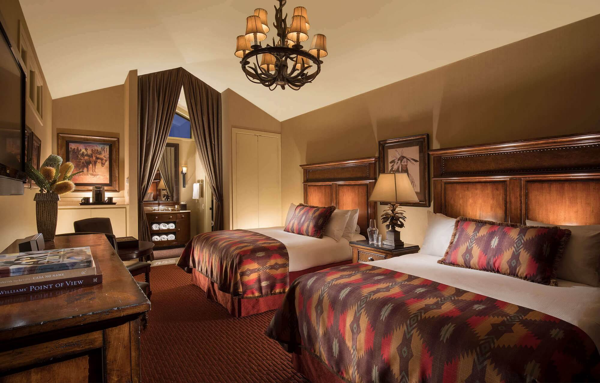luxury cabin with two king beds, decorated in an American West theme