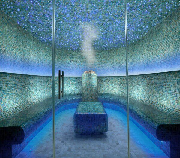 large, blue tiled steam room