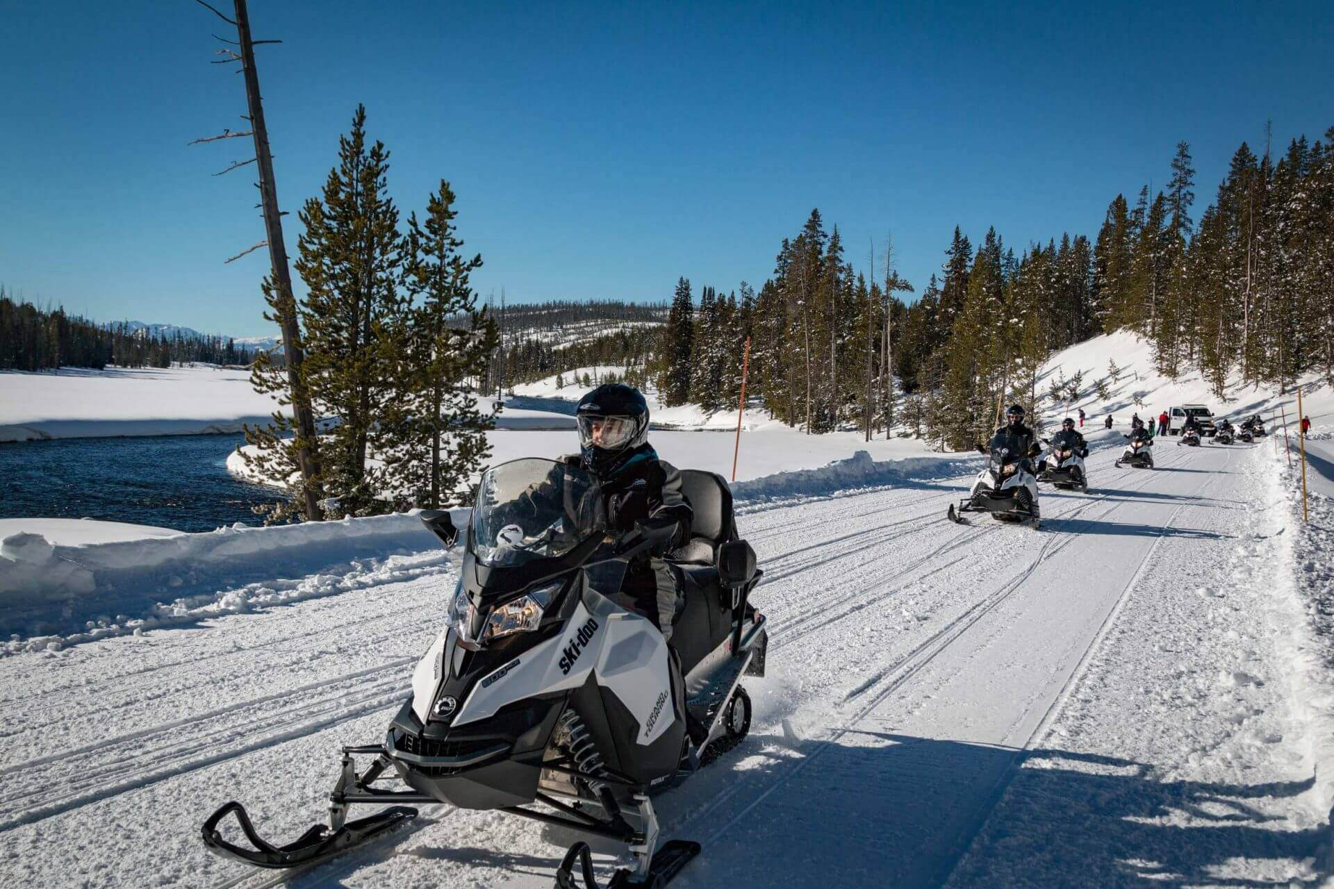 snowmobilers driving in Yellowstone