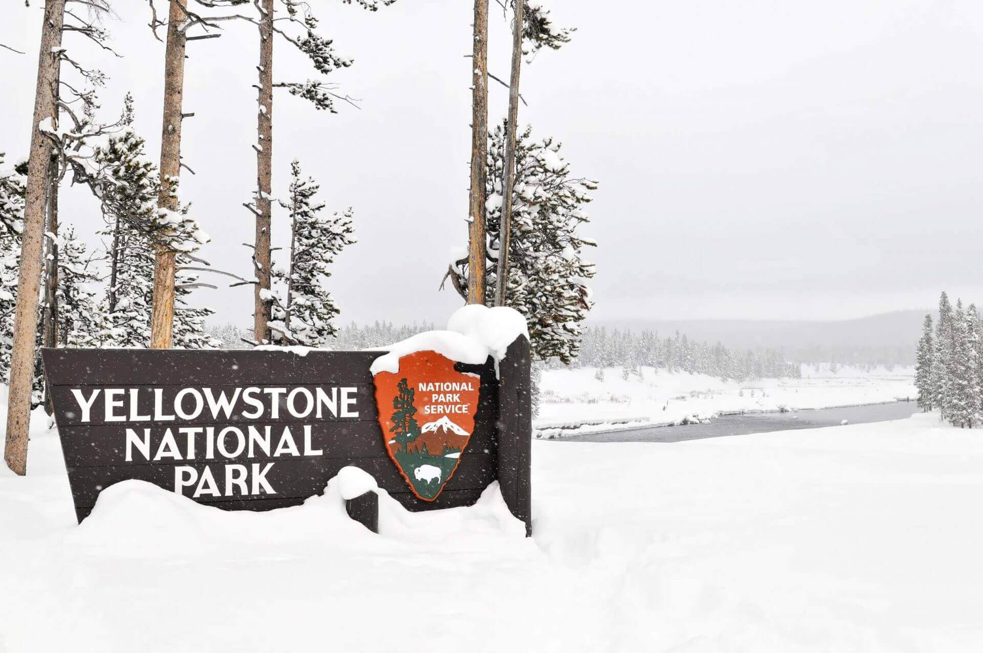 Yellowstone National Park entrance sign in winter