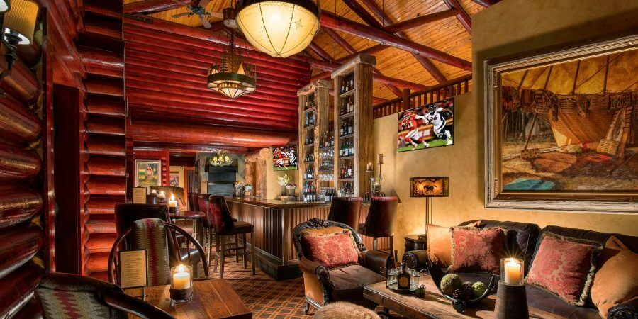 Rustic Inn bar decorated with log beams and wood furniture