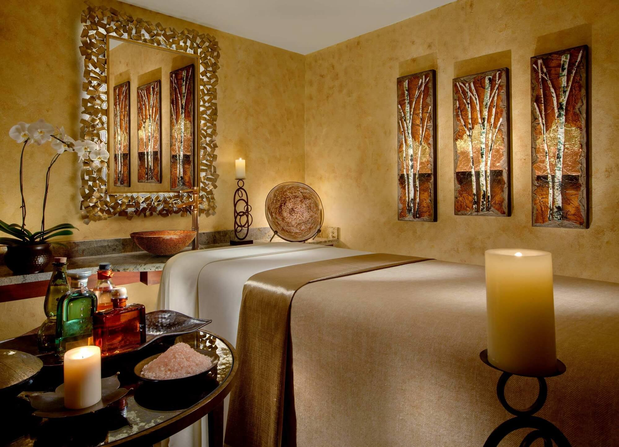 massage room with candles, salts and oils on a table