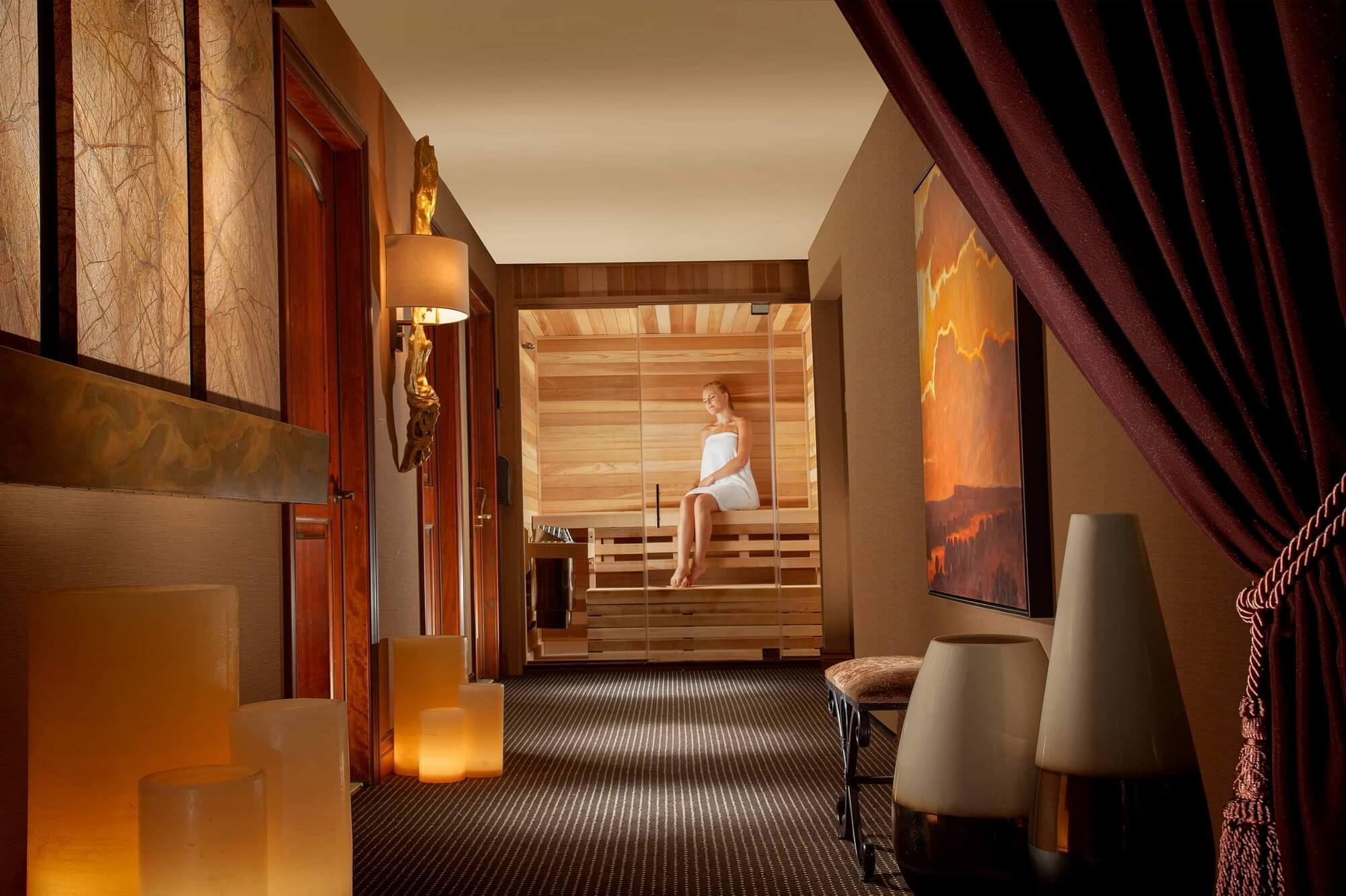view of hallway looking at woman enjoying sauna
