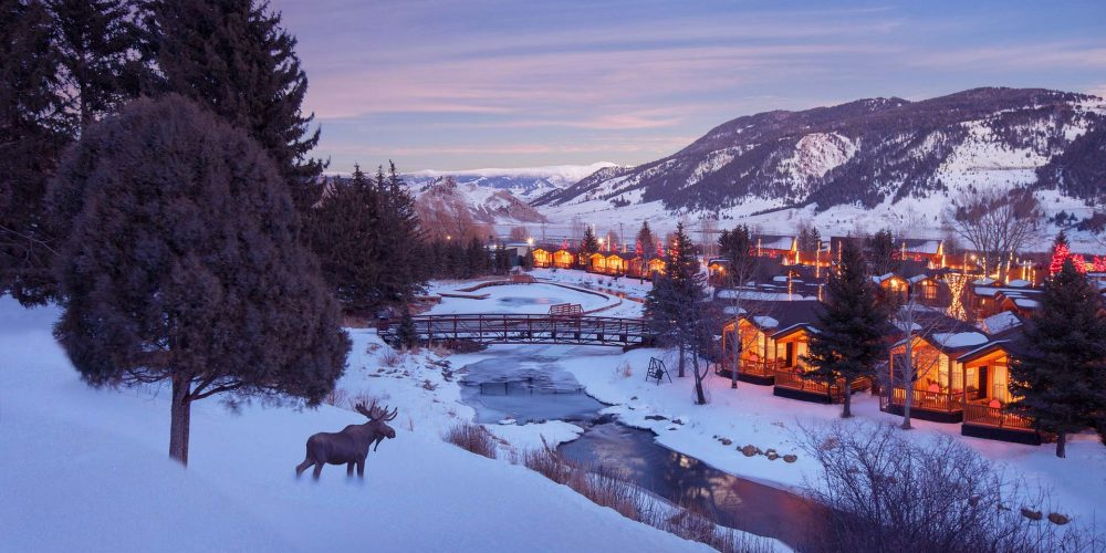 winter twilight view of cabins at rustic inn
